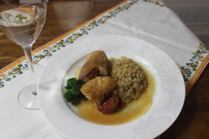 Stuffed chicken roulade with white wine sauce.
